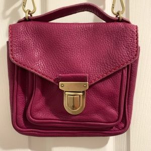 Roots fuchsia leather cross body bag